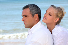 Couple at the beach Stock Photos