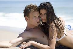 Couple on a beach Royalty Free Stock Photos