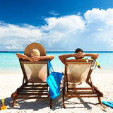 Couple on a beach. Couple on a tropical beach at Maldives stock images