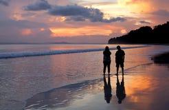 Couple on the beach. Couple on the beach watching sunset, Andaman Island, India Stock Photos
