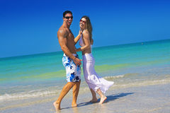 Couple at beach. Happy couple having fun at the beach Royalty Free Stock Images