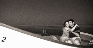 Couple at the beach. Engagement portrait. Film grain visible Stock Photos