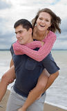 Couple on the beach. An attractive couple playing around on the beach Stock Photo