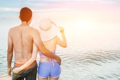 Couple on the beach. Asian couple walking on the beach when the sun is about to sunset during the honeymoon. There are  Couple walking on Valentine`s Day Royalty Free Stock Photo