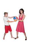 Couple with Beach Ball Royalty Free Stock Photography