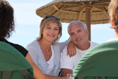 Couple in a beach bar Stock Photography