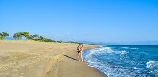 The couple on the beach. The couple on the beautiful sandy Kaiafas beach, Greece stock photos