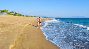 The couple on the beach. The couple on the beautiful sandy Kaiafas beach, Greece royalty free stock photos