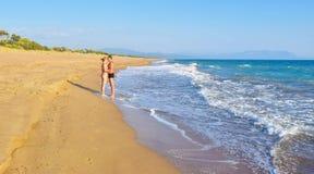 The couple on the beach. The couple on the beautiful sandy Kaiafas beach, Greece royalty free stock photography