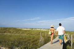 Couple on Beach Boardwalk Royalty Free Stock Photo