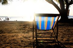 Couple beach chair on the beach with sunset sky background stock images
