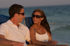 Couple in beach chairs Stock Photos