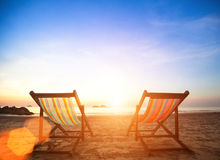 Couple of beach chairs on sea coast. Luxury Travel. Royalty Free Stock Photo