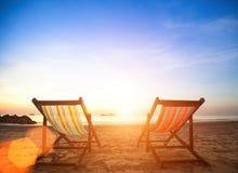 Couple of beach chairs on sea coast. Luxury Travel. Royalty Free Stock Photo
