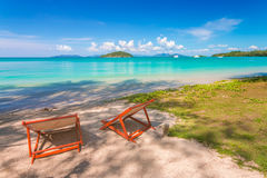 Couple of beach chairs on sea coast at Thailand Royalty Free Stock Photos