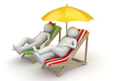 Couple on beach chairs under umbrella Royalty Free Stock Image