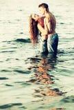 Couple at the beach Royalty Free Stock Photos