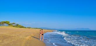 The couple on the beach. The couple on the beautiful sandy Kaiafas beach, Greece stock photo