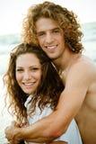 Couple at the beach embracing Stock Photos