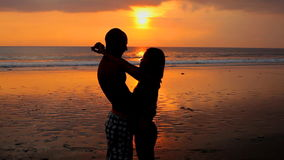 Couple on beach. Couple embracing each other on beach at sunset in Bali stock footage