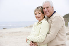 Couple at the beach embracing and smiling Stock Photography