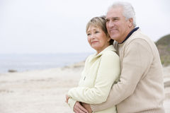 Couple at the beach embracing and smiling Royalty Free Stock Photography