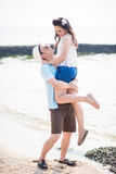 Couple on the beach. Happy and relax couple expression. Asian couple Royalty Free Stock Image