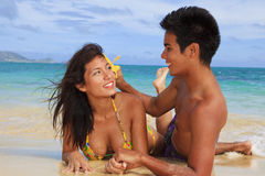 Couple on beach in hawaii Stock Images