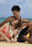 Couple on the beach in hawaii Stock Photo