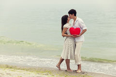 Couple at the beach with heart. Stock Photo
