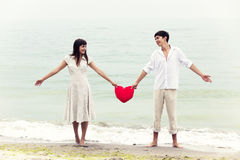 Couple at the beach with heart. Royalty Free Stock Photo