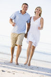 Couple at the beach holding hands and smiling Royalty Free Stock Photo