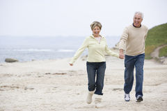 Couple at the beach holding hands and smiling Royalty Free Stock Image