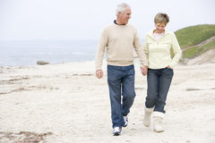 Couple at the beach holding hands and smiling Stock Image