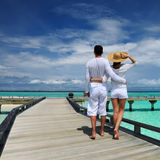 Couple on a beach jetty at Maldives. Couple on a tropical beach jetty at Maldives Stock Images