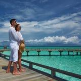 Couple on a beach jetty at Maldives Stock Photos