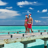 Couple on a beach jetty at Maldives Stock Images