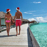 Couple on a beach jetty at Maldives. Couple on a tropical beach jetty at Maldives Stock Photo