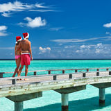 Couple on a beach jetty at Maldives. Couple on a tropical beach jetty at Maldives Stock Image