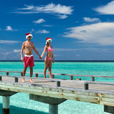 Couple on a beach jetty at Maldives. Couple on a tropical beach jetty at Maldives Royalty Free Stock Image