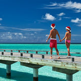 Couple on a beach jetty at Maldives Stock Image