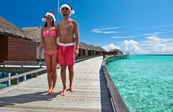 Couple on a beach jetty at Maldives. Couple on a tropical beach jetty at Maldives Stock Photography