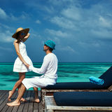Couple on a beach jetty at Maldives Royalty Free Stock Photos