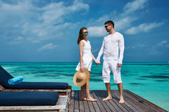Couple on a beach jetty at Maldives Royalty Free Stock Photo