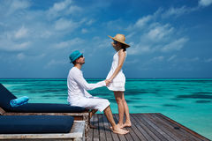 Couple on a beach jetty at Maldives Royalty Free Stock Images