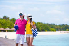 Couple on beach jetty at tropical island Royalty Free Stock Photography
