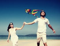 Couple Beach Kite Flying Getaway Holiday Concept Stock Image