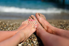 Couple on the beach. Legs of loving couple on the beach close up Royalty Free Stock Images