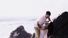 Couple at the beach stock footage