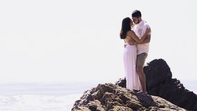 Couple at the beach stock video footage